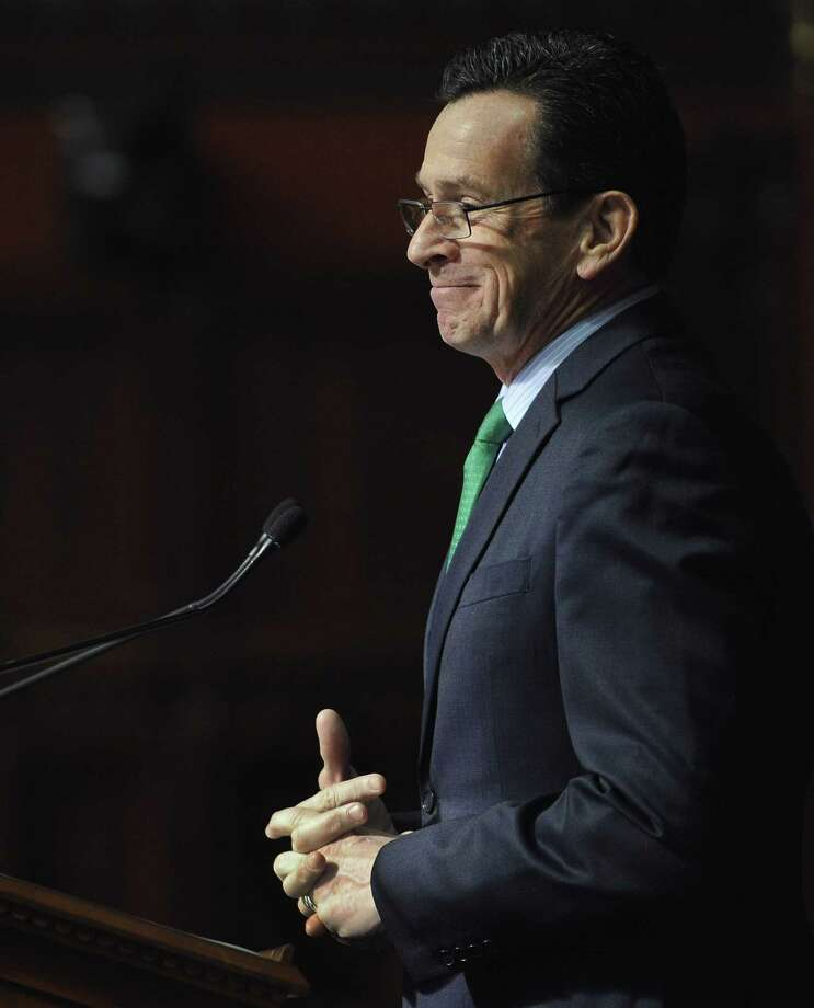 Connecticut Gov. Dannel P. Malloy delivers his budget address to the senate and house inside the Hall of the House at the State Capitol Feb. 18 in Hartford. Photo: File Photo  / FR125654 AP