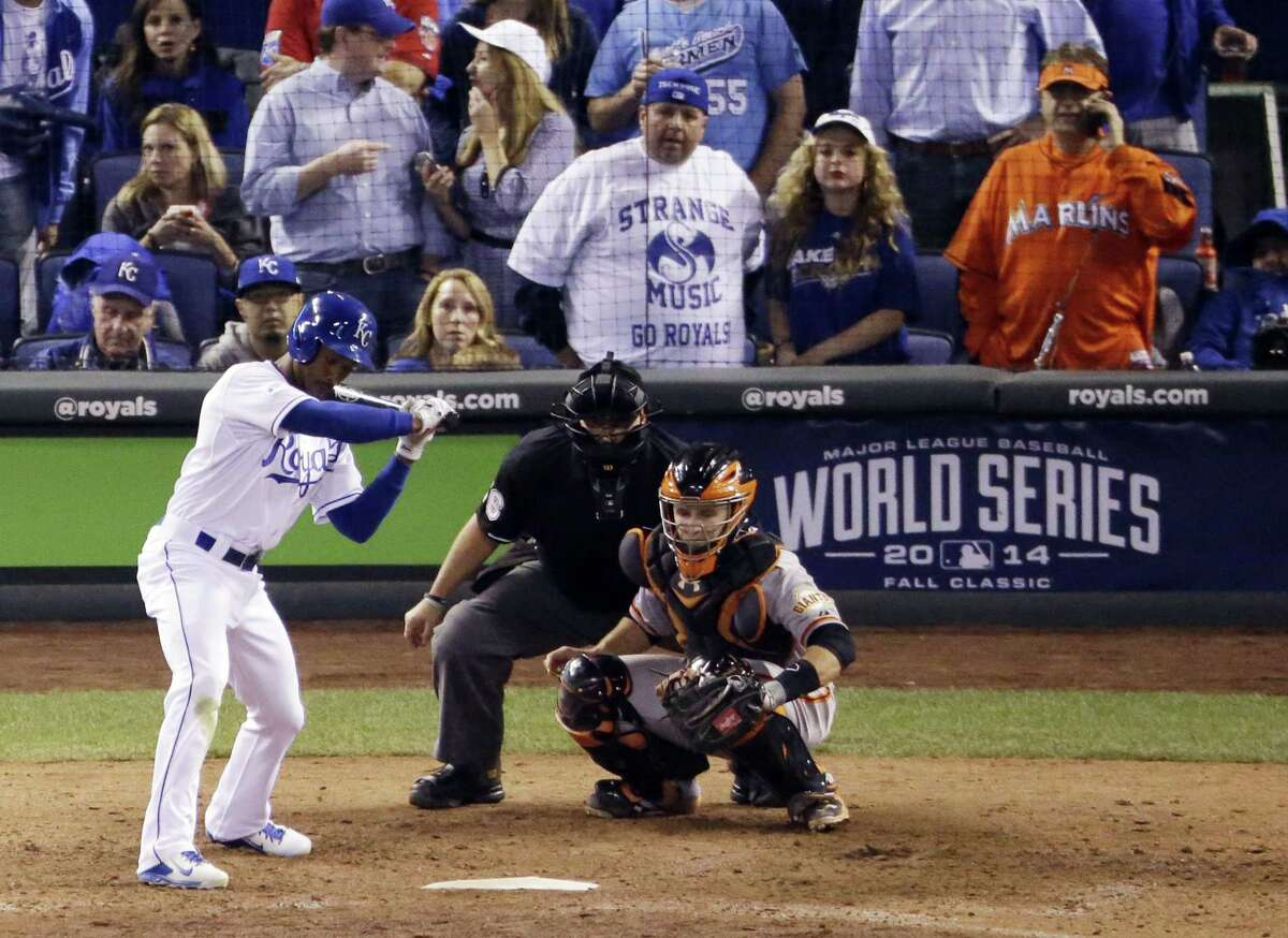 Miami Marlins fan Laurence Leavy wears a bright orange Marlins jersey during Game 2 of the World Series on Wednesday in Kansas City, Mo. Leavy said a Royals official approached him offering to move him to the team owner's suite, but Leavy declined.