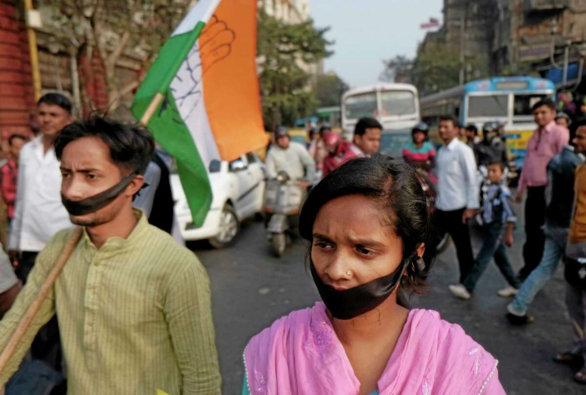 FILE - In this Friday, Jan. 3, 2014 file photo, activists of Indian National Congress with black bands around their mouths block traffic during a protest against a gang rape and murder of a 16-year-old girl at Madhyamgram, about 25 kilometers (16 miles) north of Kolkata in West Bengal, India. Her death on New Year's Eve came more than a year after a deadly gang rape in New Delhi raised awareness and outrage over chronic sexual violence in India and government failures to protect women. The New Delhi rape was considered a major reason for why voters ousted the capital's government last month, and the furious response to the West Bengal case suggests that with general elections just months away, politicians remain anxious to impress voters who are demanding that women's safety become a police priority. (AP Photo/Bikas Das, File)