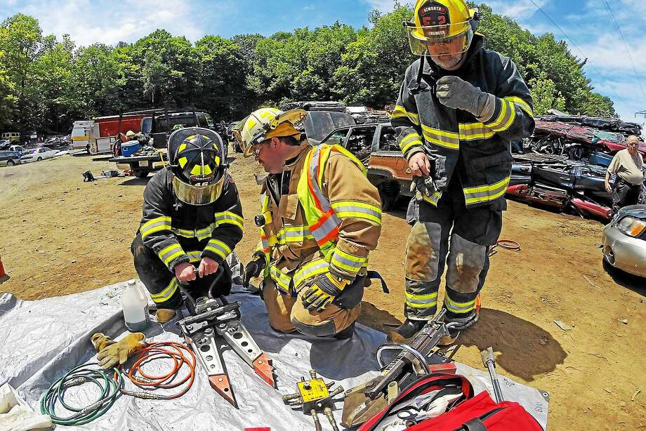 On June 14, Haddam Volunteer Fire Company Chief Sam Baber provided a four-hour safety lesson, training and hands-on tool demonstration with seven Acworth Volunteer Fire and Rescue Company members. Photo: Olivia Drake —  Haddam Volunteer Fire Company