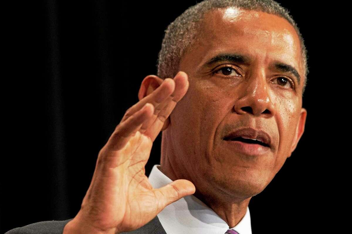 This June 25, 2014 photo shows President Barack Obama speaking in Washington.