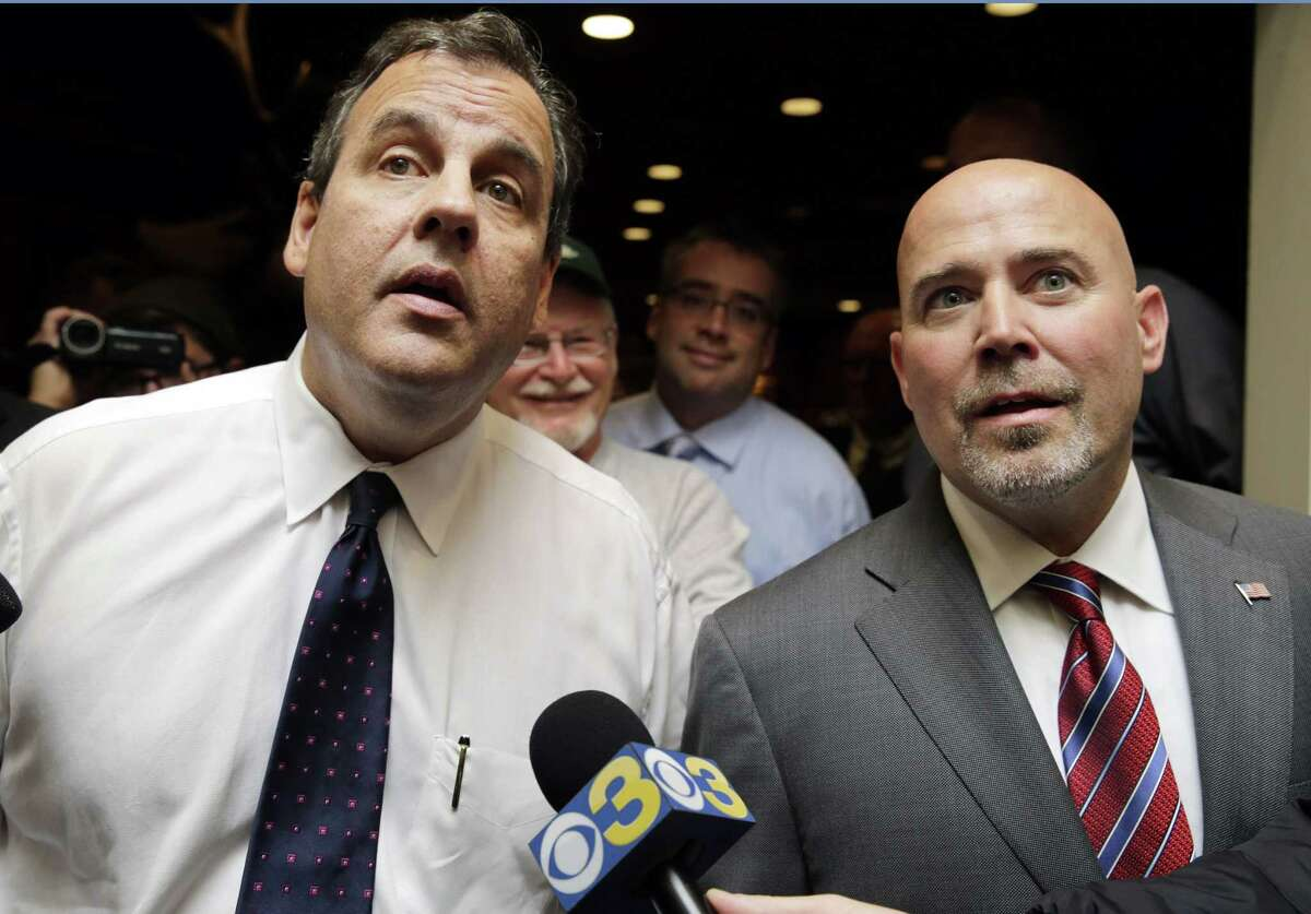 New Jersey Gov. Chris Christie, left, and Republican candidate for New Jersey's 3rd Congressional District, Tom MacArthur, right, listen to a question Thursday in Bordentown, N.J.