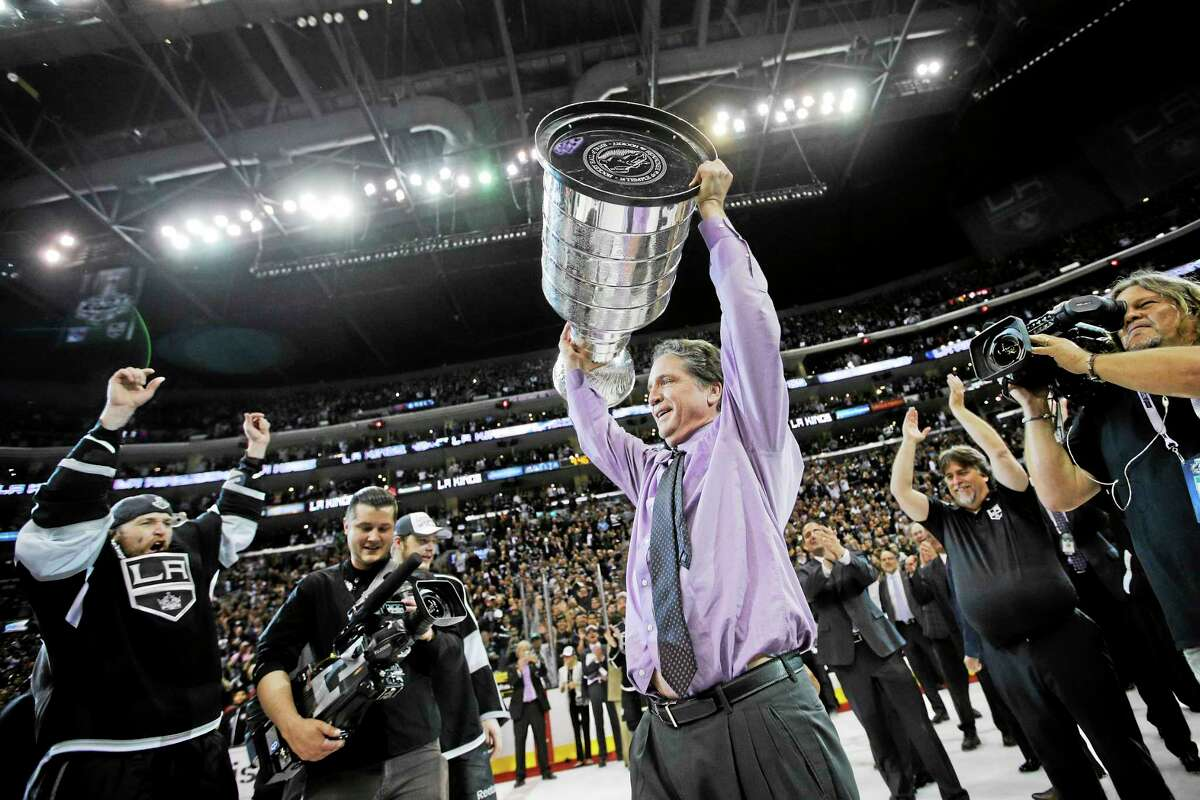 Los Angeles general manager Dean Lombardi, a University of New Haven graduate, raises the Stanley Cup after the Kings beat the New York Rangers on June 13, 2014.