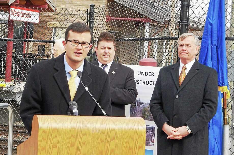 Sen. Art Linares (at podium) speaks during a press conference last year to formally open the new Westbrook train station serving Shore Line East customers alnog with Rep. Tom Vicino, center, and Department of Transportation Commissioner James P. Redeker, right. Photo: File Photo