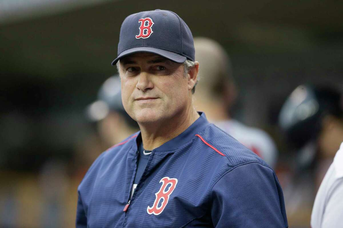 The Red Sox say manager John Farrell's cancer is in remission.