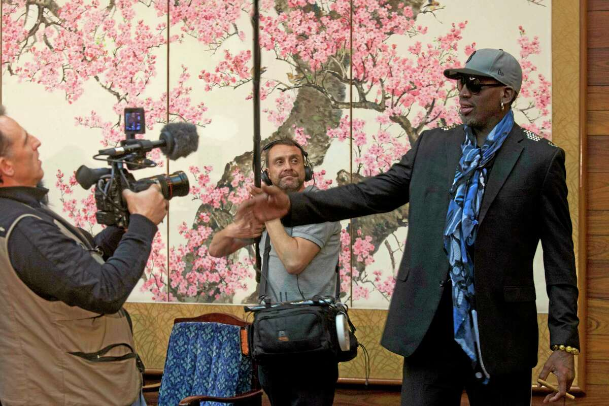 Dennis Rodman is filmed by a documentary film crew at a Pyongyang, North Korea hotel Tuesday, Jan. 7, 2014. Rodman came to the North Korean capital with a team of USA basketball stars for an exhibition game on Jan. 8, the birthday of North Korean leader Kim Jong Un. (AP Photo/David Guttenfelder)