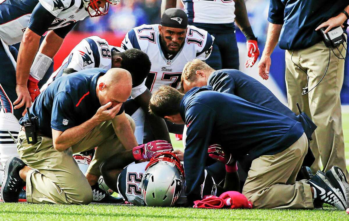 Trainers assist Stevan Ridley after he was injured during an Oct. 12, 2014 game.