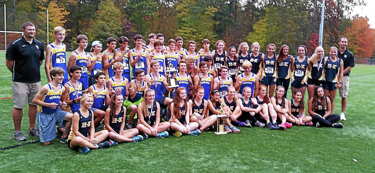 Jimmy Zanor - Middletown PressThe Haddam-Killingworth boys and girls cross country teams each captured SLC championships on Thursday.