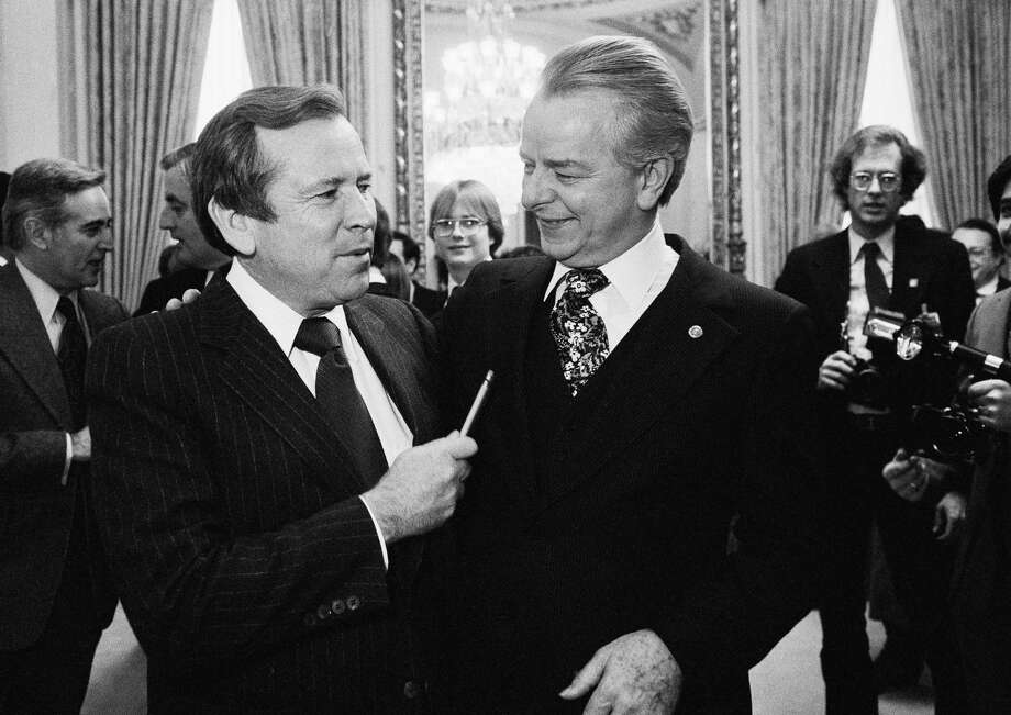 This Dec. 4, 1980, file photo shows Senate Majority Leader Robert Byrd of W.Va., right, talking to the man who will replace him, Sen. Howard Baker, R-Tenn., on Capitol Hill in Washington. Baker, who asked what President Richard Nixon knew about Watergate, has died. He was 88. Baker, a Republican, served 18 years in the Senate. He earned the respect of Republicans and Democrats alike and rose to the post of majority leader. He served as White House chief of staff at the end of the Reagan administration and was U.S. ambassador to Japan during President George W. Bush's first term. Photo: AP File Photo/Chick Harrity  / AP