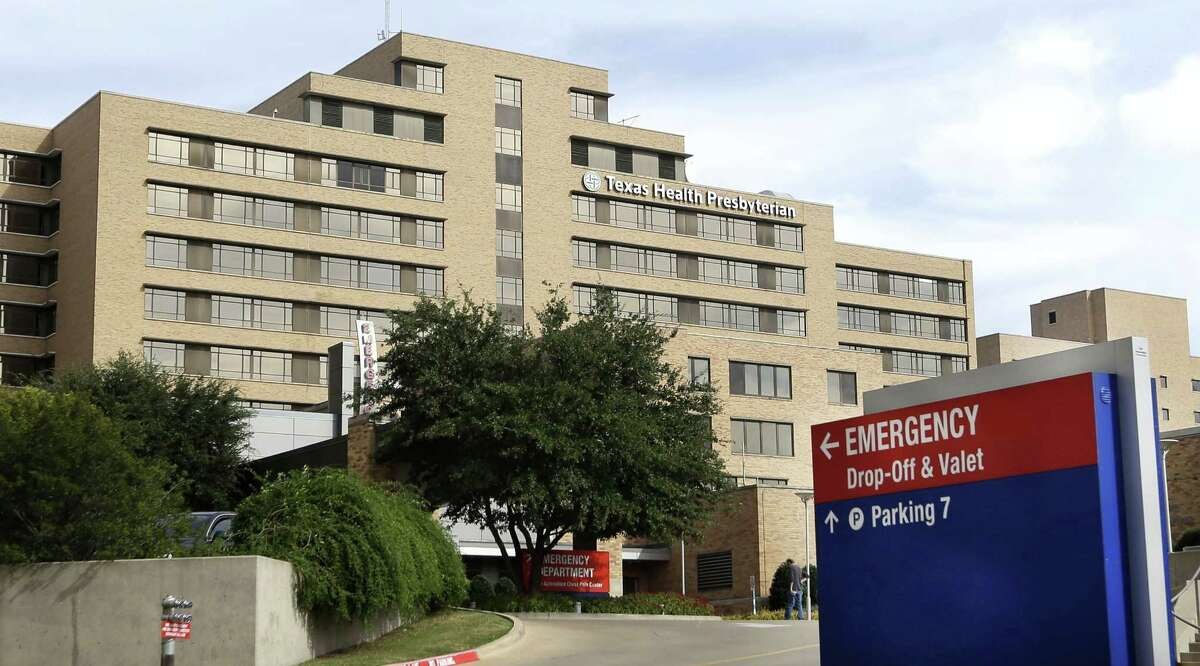 FILE - In this Oct. 8, 2014, file photo, a sign points to the emergency room entrance at Texas Health Presbyterian Hospital. It may not matter much that Texas Health Presbyterian Hospital Dallas apologized for initially misdiagnosing Duncan, who was sent home from the emergency room but later returned sicker and farther along on a painful decline to death from Ebola. Insulated by Texas tort reform that gives an extra layer of protection to emergency room doctors and nurses, not only is the very feasibility of winning a lawsuit complicated, but the potential payout is severely capped.(AP Photo/LM Otero, File)
