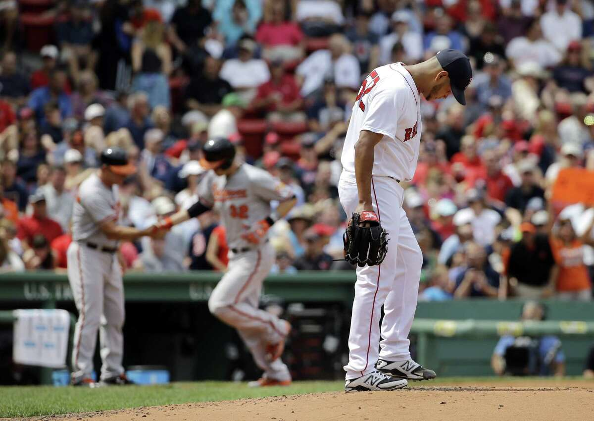 Red Sox starter Eduardo Rodriguez reacts after giving up a two-run home run to Baltimore Orioles catcher Matt Wieters on Thursday afternoon in Boston.