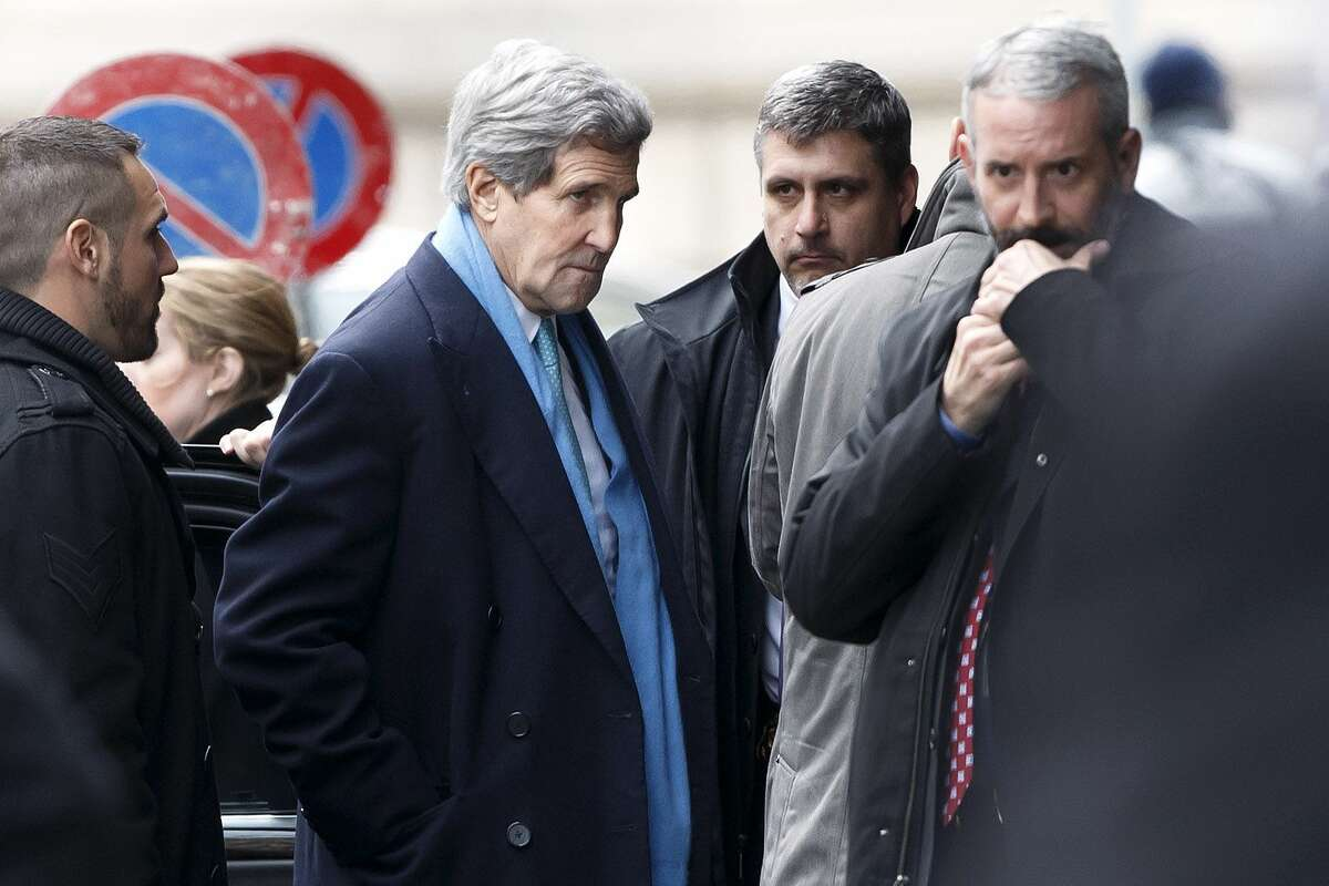 U.S. Secretary of State John Kerry, center, arrives at a hotel prior to a bilateral meeting with Iranian Foreign Minister Mohammad Javad Zarif for a new round of Nuclear Talks in Geneva, Switzerland on Feb. 22, 2015.