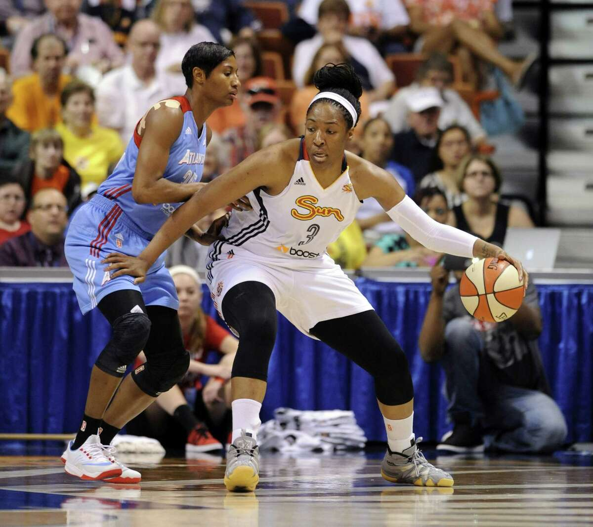 Connecticut's Kelsey Bone (3) is guarded by the Atlanta Dream's Angel McCoughtry during the Sun's 82-64 win on June 14 in Uncasville.