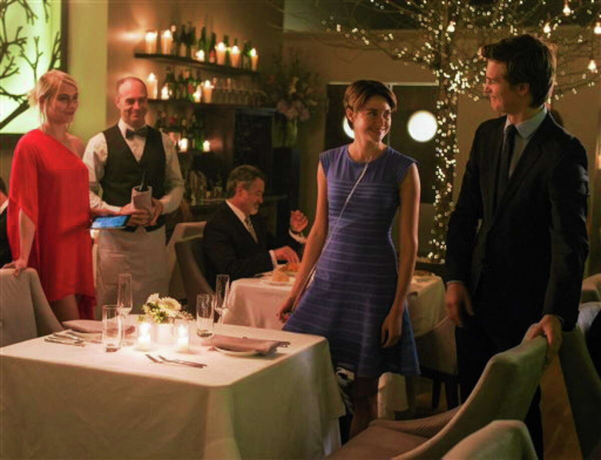 """This image released by 20th Century Fox shows Ansel Elgort, right, and Shailene Woodley appear in a scene from """"The Fault In Our Stars."""" (AP Photo/20th Century Fox, James Bridges)"""
