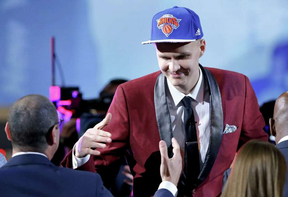 Kristaps Porzingis is congratulated by supporters after being selected fourth overall by the New York Knicks at the NBA draft on Thursday. Photo: Kathy Willens — The Associated Press  / AP