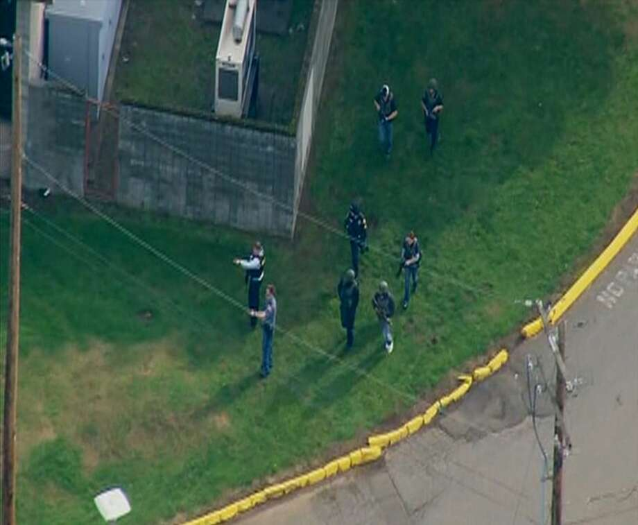 This image made from a video provided by KOMO shows emergency personnel responding after reports of a shooting at Marysville-Pilchuck High School in Marysville, Wash., Friday. Photo: Associated Press/KOMO  / KOMO