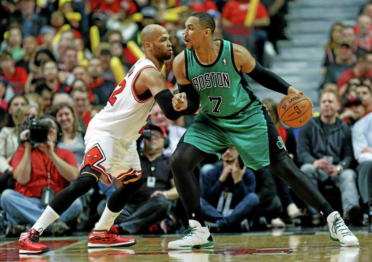 In this March 31 file photo, Chicago Bulls forward Taj Gibson, left, defends Boston Celtics center Jared Sullinger.