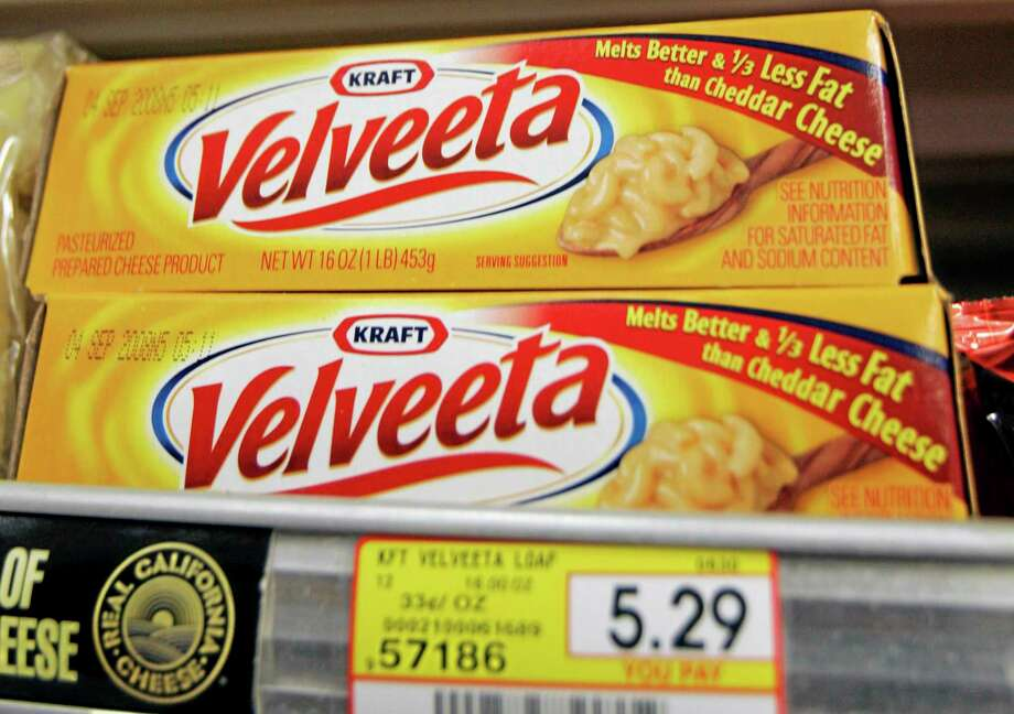 FILE- In this Monday, July 28, 2008, file photo, Kraft Foods' Velveeta cheese is displayed at J. J. & F. Market in Palo Alto, Calif.. Kraft Foods says Tuesday, Jan. 7, 2014, some customers may not be able to find Velveeta products over the next few weeks but didnít give any reasons for the apparent shortage.  (AP Photo/Paul Sakuma, File) Photo: AP / AP