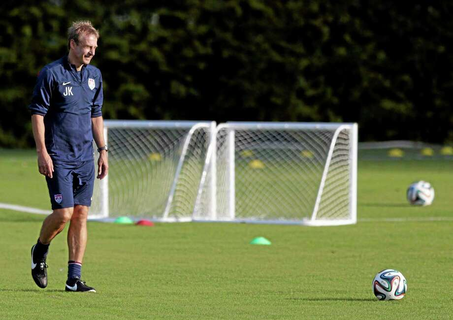 United States coach Jurgen Klinsmann walks a practice field during a training session on Monday in Sao Paulo, Brazil. The U.S. will play Germany in a group G World Cup match on Thursday in Recife, Brazil. Photo: Julio Cortez — The Associated Press  / AP