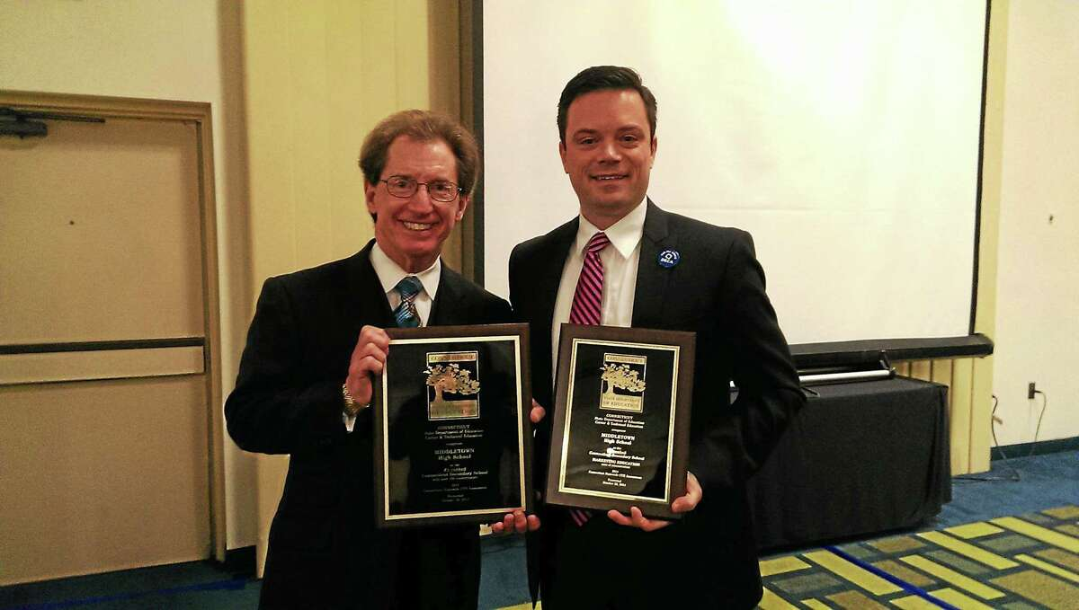 From left are Dr. Stephen Hoag, consultant, state Department of Education, and David Reynolds, coordinator of Career and Technical Education and Distributive Education Club of America adviser at Middletown Public Schools.