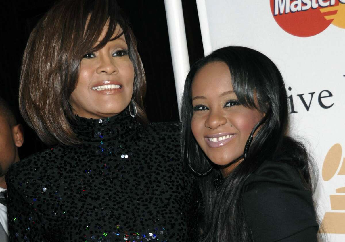 In this Feb. 12, 2011 photo, singer Whitney Houston, left, and daughter Bobbi Kristina Brown arrive at an event in Beverly Hills, Calif. Brown is moving to hospice care after months of receiving medical care.