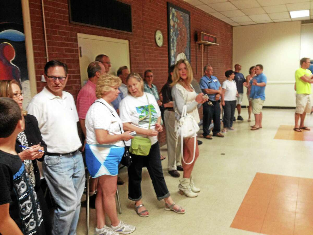 In this file photo from last year's referendum, East Hampton voters gather at the polls, waiting their turn to cast a ballot. On Wednesday, the third budget was rejected 1,230 to 1,076.