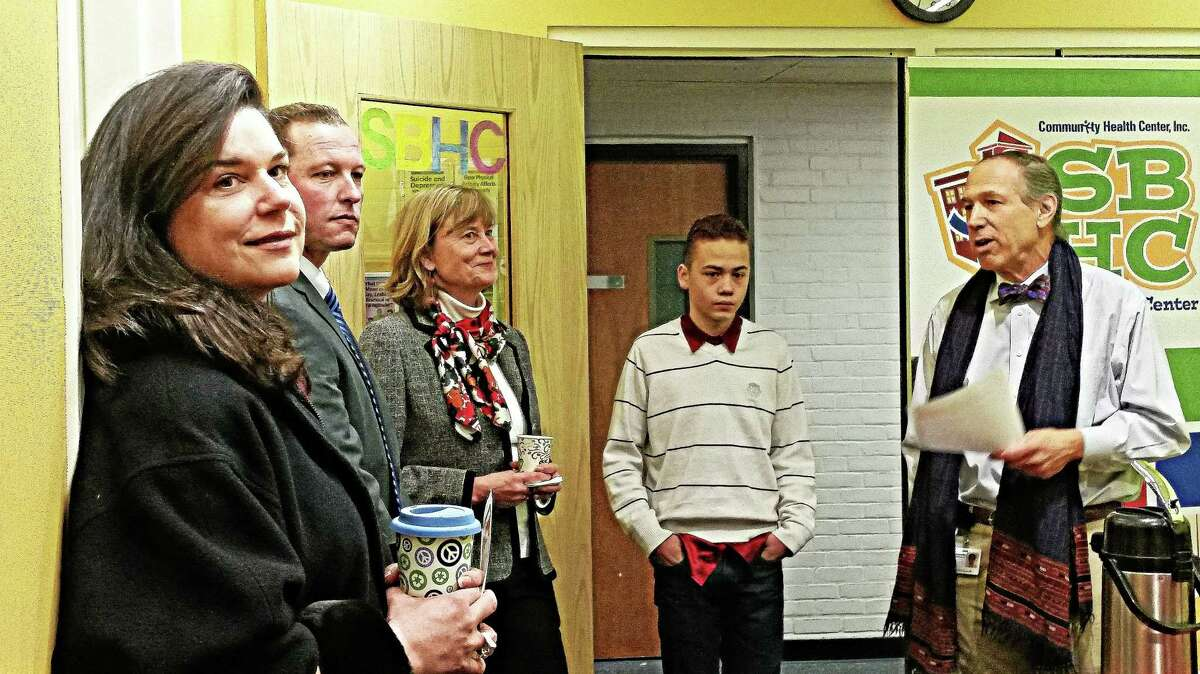 Kathleen Schassler/Middletown Press Student advocate Onix Rivera shares that mental-behavioral health support and counseling received as a Middletown student helped him to turn anger into achievement. State legislators and school officials gathered on Monday at a school-based health center. Community Health Center staff spoke about current services and fears over impending state funding cuts. Senator Dante Bartolomeo; Dr. Patricia Charles, Superintendent of Schools; Enza Macri, Associate Superintendent; Robert Conroy, Principal of Woodrow Wilson Middle School, Mark Masselli, President and CEO of Community Health Center, Inc.