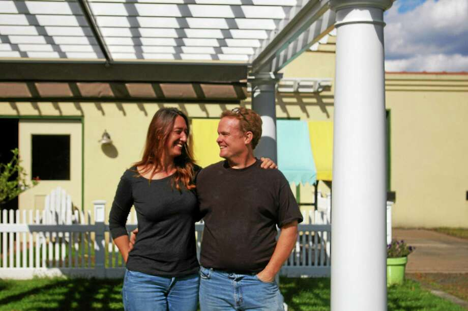 Husband and wife Max and Cheri Baldwin bought Baldwin Furniture's Middlefield Street location in 2006 and have been expanding the business with the changing economy ever since. Here they stand beneath one of the firm's popular pergolas. Photo: Aysha Mahmood — Special To The Press