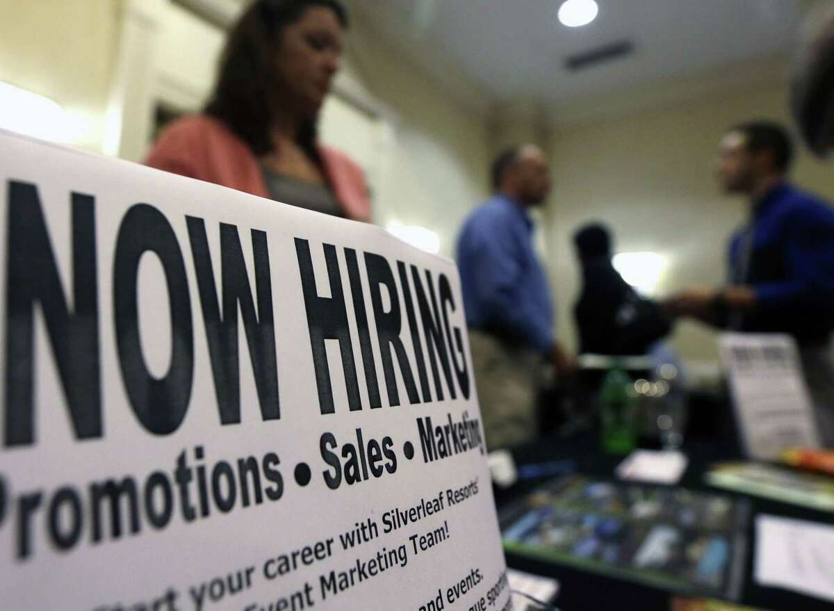 In this 2012 file photo, a sign attracts job-seekers during a job fair that took place at the Marriott Hotel in Colonie, N.Y.