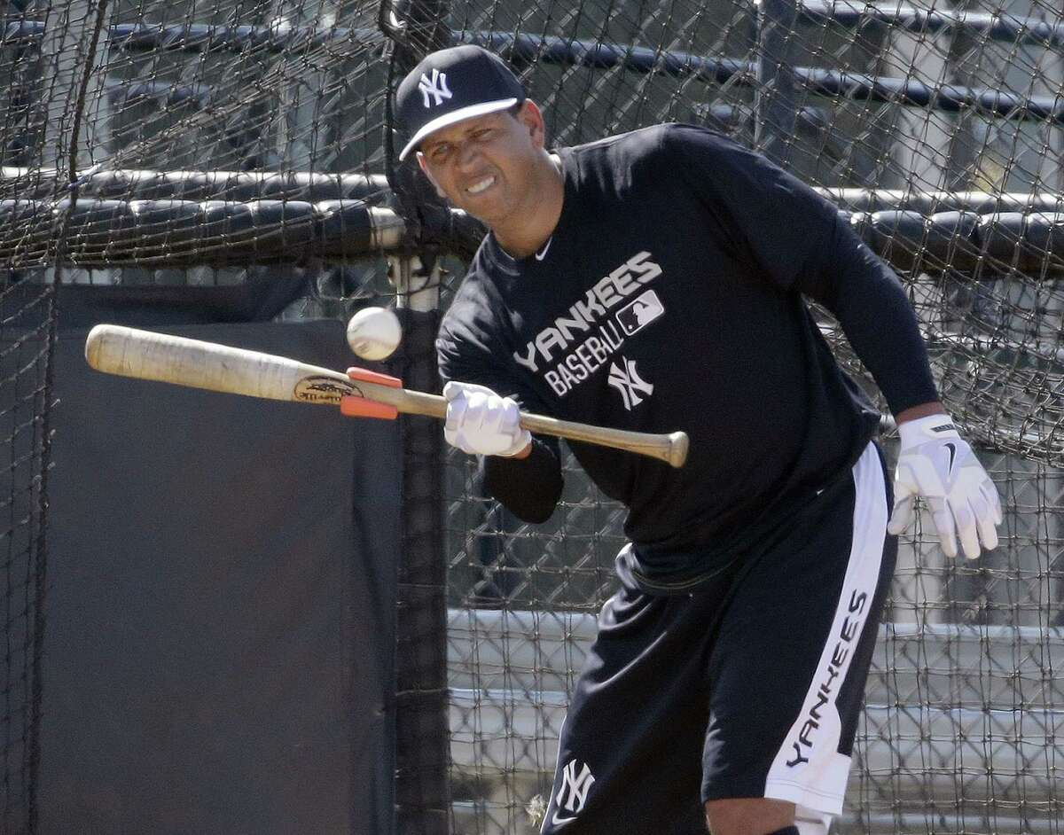 New York Yankees third baseman Alex Rodriguez bunts the ball while taking bating practice at the Yankees' minor league complex Monday, Feb. 23, 2015, in Tampa, Fla. (AP Photo/Chris O'Meara)