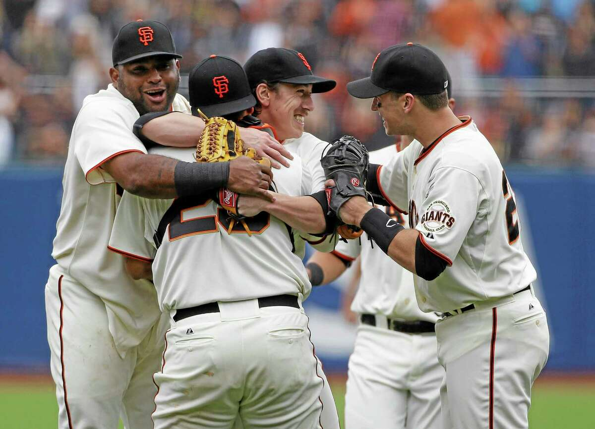 Giants pitcher Tim Lincecum, center, is embraced by teammates after throwing a no-hitter against the San Diego Padres on Wednesday in San Francisco.