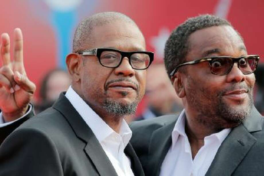 "Director Lee Daniels, right, jokes as he and actor Forest Whitaker, left, arrive for the screening of their film ""The Butler"" at the 39th American Film Festival in Deauville, Normandy, western France on Aug. 31, 2013."