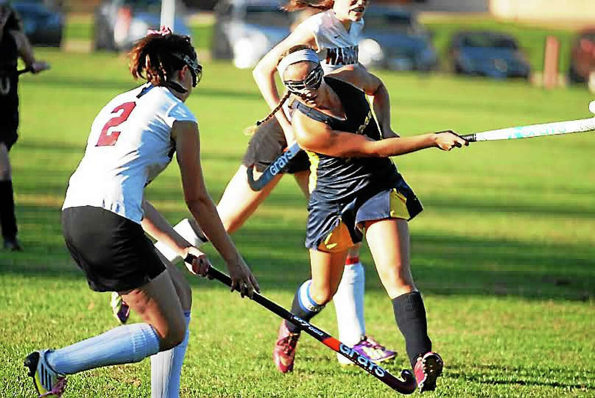 Haddam-Killingworth's Julie Hausherr on the attack. H-K coach Patsy Kamercia is in her 41st season and the team is looking as good ever.