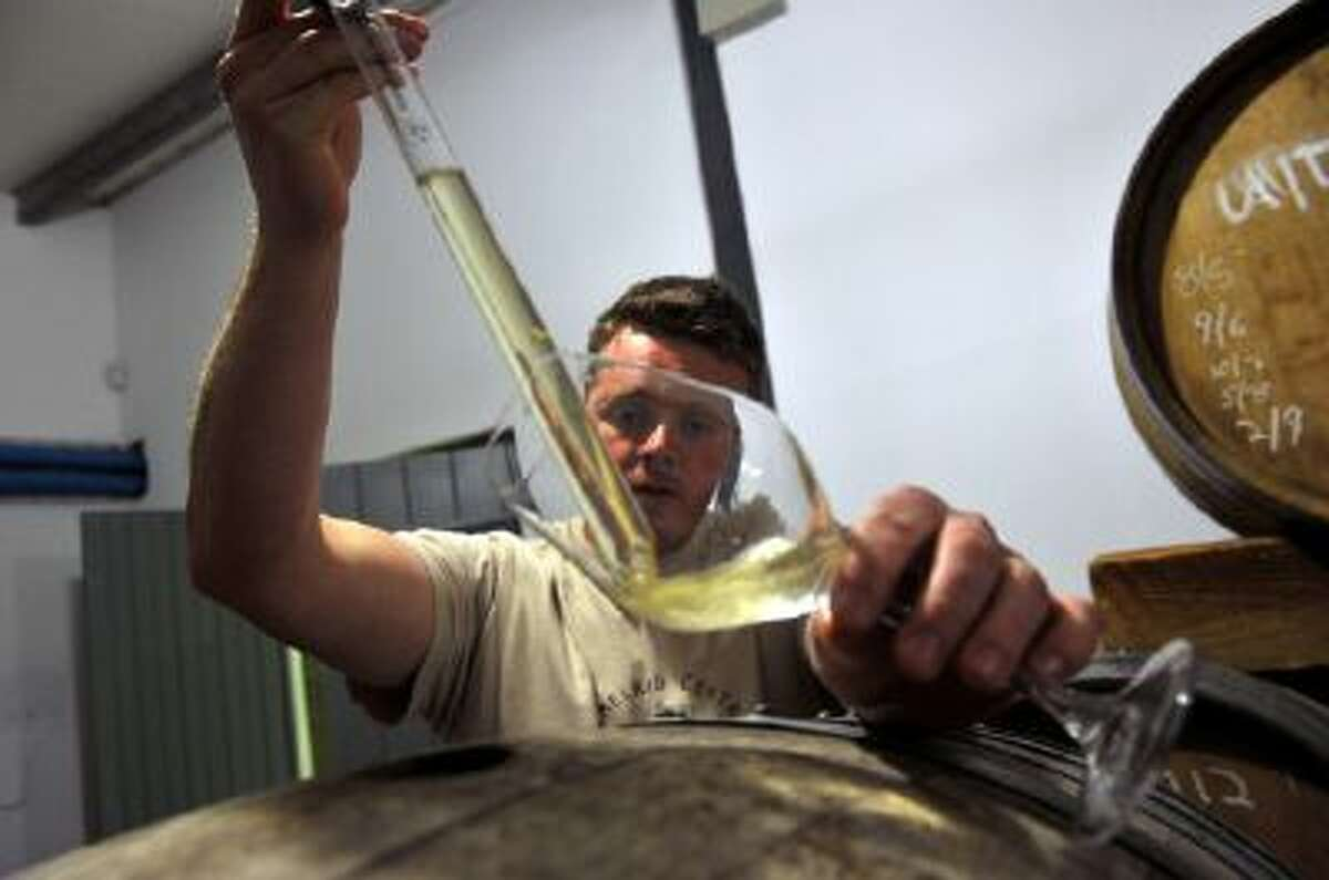 Chris Alheit tests one of his wines in Hemelrand in Western Cape on September 5, 2013. He is determined to create not only world-beating wine, but one which is distinctly South African.
