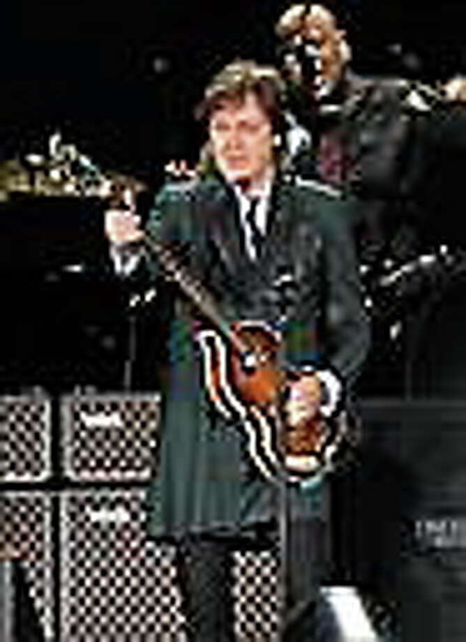 File- This July 9, 2013, file photo shows Paul McCartney performing at Fenway Park in Boston. McCartney is rescheduling U.S. tour dates as he continues to recover from a virus he received treatment for last month. The former Beatles singer announced Monday, June 9, 2014, tour stops scheduled for mid-June will be postponed to October. He was supposed to kick off the U.S. leg of his tour Saturday. Instead his first show will be July 5 in Albany, New York. (Photo by Marc Andrew Deley/Invision/AP, File) Photo: Marc Andrew... / Invision