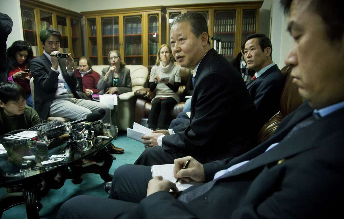 """North Korea's U.N. Ambassador Jang II Hun, third from right, is seated between North Korea's mission consulars Kin Song, second from right, and Kwon Jong Gun, far right, as he speaks during a press conference on Feb. 16 at North Korea's Mission in New York. North Korea says it will respond """"very strongly"""" to a conference in Washington on Tuesday about its widespread human rights abuses."""