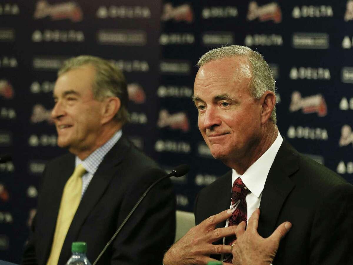 John Hart, right, speaks as Braves president John Schuerholz looks on during a news conference in Atlanta on Wednesday.