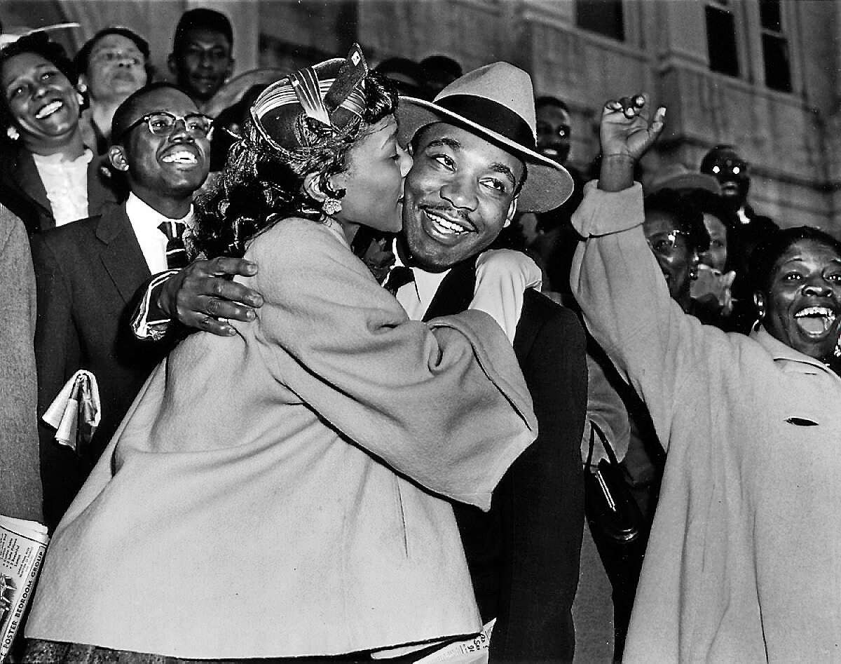 The Rev. Martin Luther KIng Jr. gets a kiss from his wife, Coretta, after leaving court in Montgomery, Ala., on March 22, 1956.