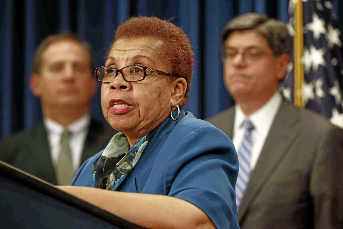 Social Security Commissioner Carolyn W. Colvin, center, accompanied by Acting Labor Secretary Seth D. Harris, left, and Treasury Secretary Jacob Lew, speaks during a news conference about Social Security and Medicare in Washington.