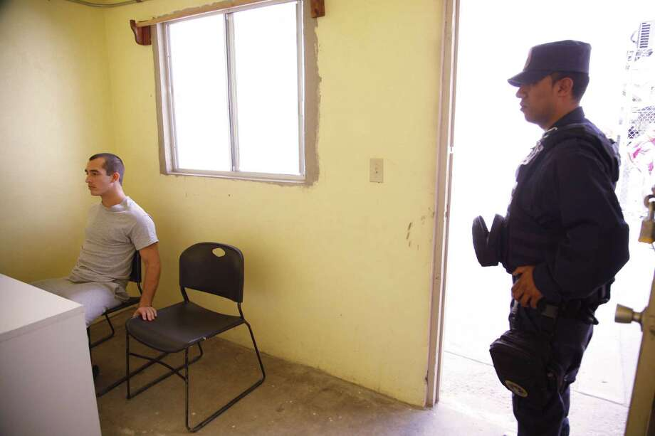 This May 3, 2014, photo shows Sgt. Andrew Tahmooressi left, who is being held at Tijuana's La Mesa Penitentiary. His lawyer is relying on the argument to win his freedom in the shortest time possible: He needs to be release so he can go home to get treatment for his combat-related post-traumatic stress, which Mexican authorities don't treat, even in their own soldiers. (AP Photo/UT San Diego, Alejandro Tamayo) Photo: AP / UT San Diego