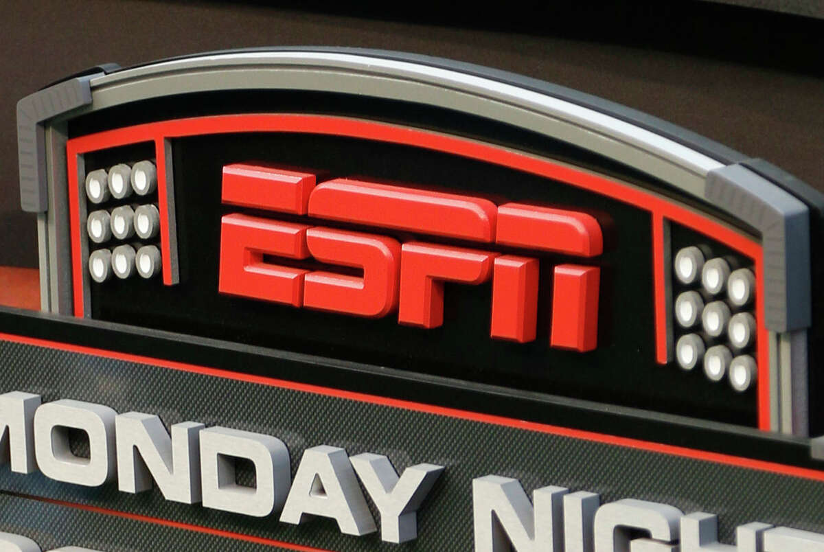This Sept. 16, 2013 photo shows the ESPN logo prior to an NFL football game between the Cincinnati Bengals and the Pittsburgh Steelers, in Cincinnati.