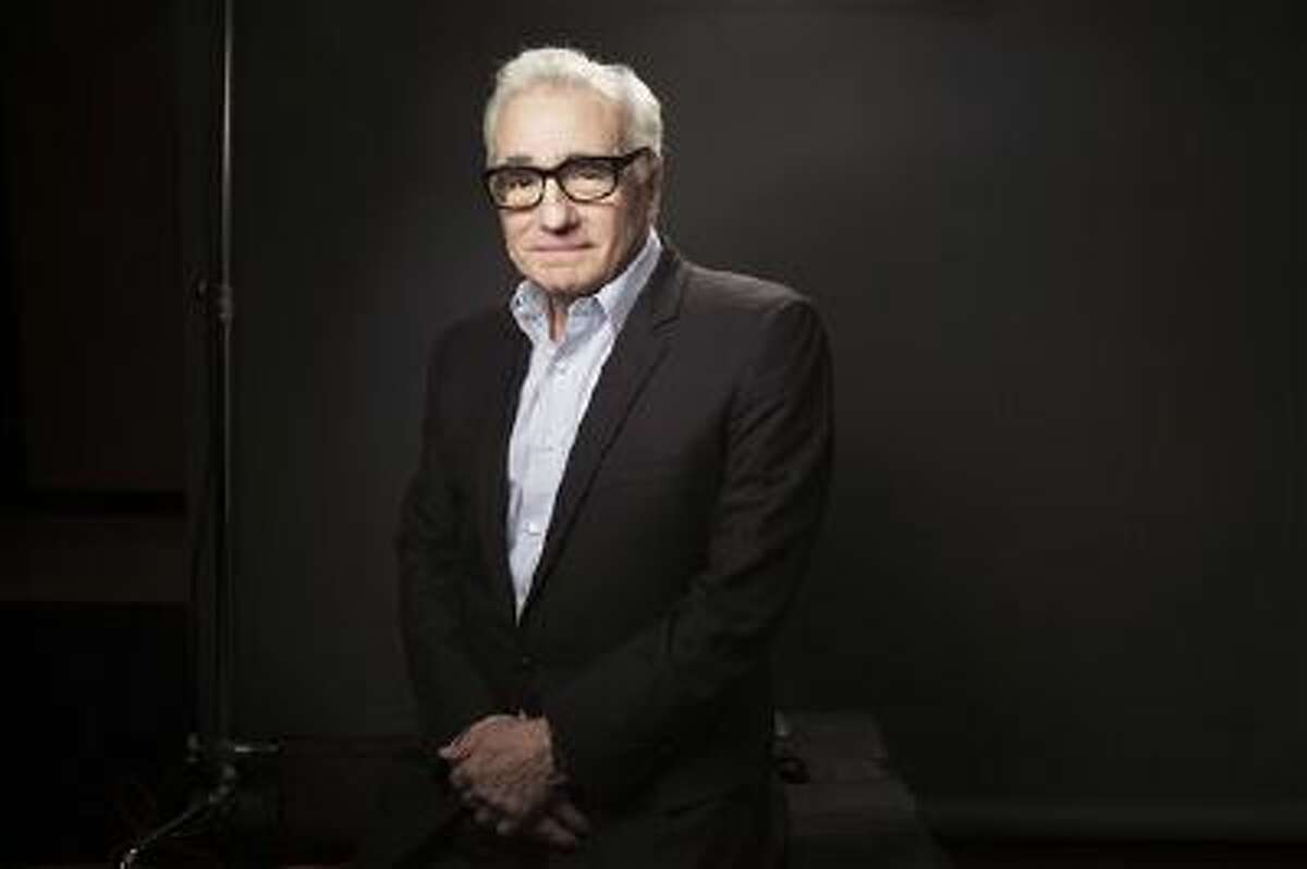 This Dec. 15, 2013 photo shows American film director Martin Scorsese in New York. Scorsese?s portrait of Wall Street excess has been judged by some critics and moviegoers as a glorification of unchecked greed. But the movie?s bad reputation as an orgy of drugs, sex and money has also drawn eager crowds.