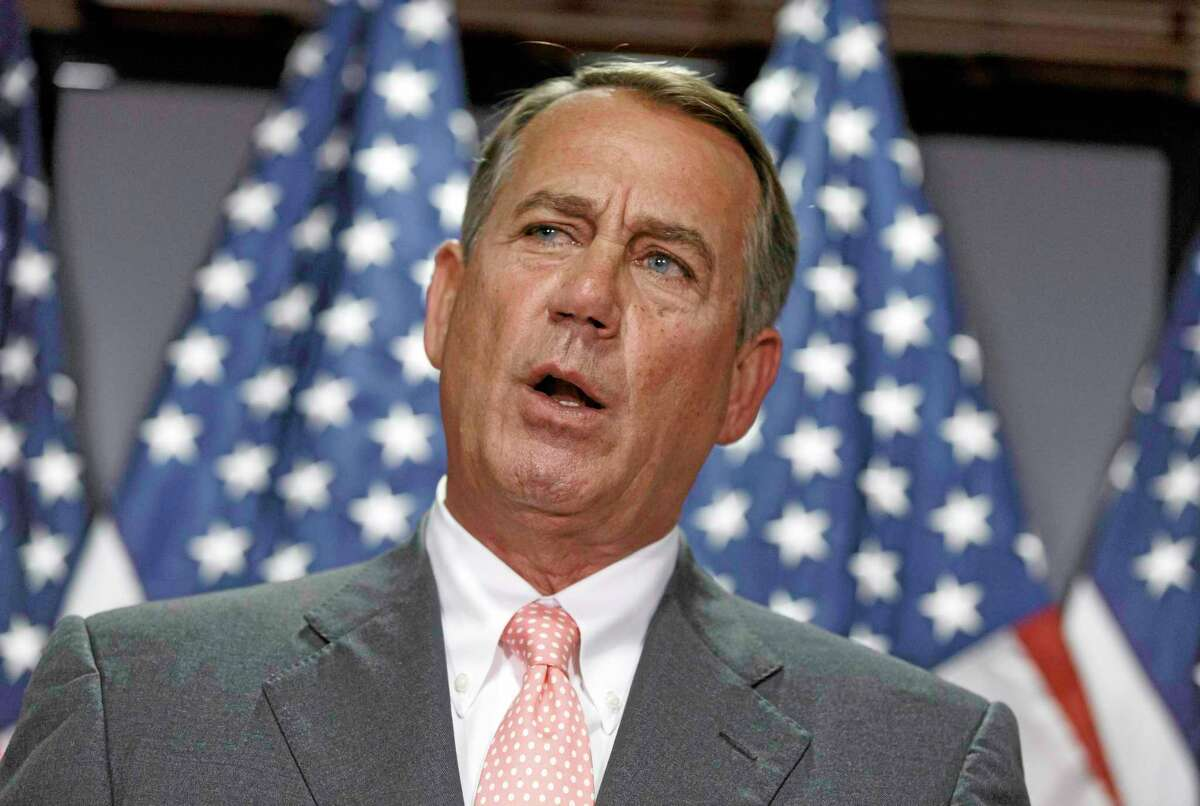 """House Speaker John Boehner of Ohio meets with reporters on Capitol Hill in Washington, Tuesday, June 24, 2014. Boehner said he's """"all in"""" to remain as House speaker in the new Congress that will meet next year. For months, some have questioned whether the Ohio Republican would remain in the House's No. 1 job after this Congress ends in January 2015. Boehner has been speaker since 2011. For much of that time, he's managed a fractious Republican majority that includes conservatives who at times have rebelled against his leadership. (AP Photo/J. Scott Applewhite)"""