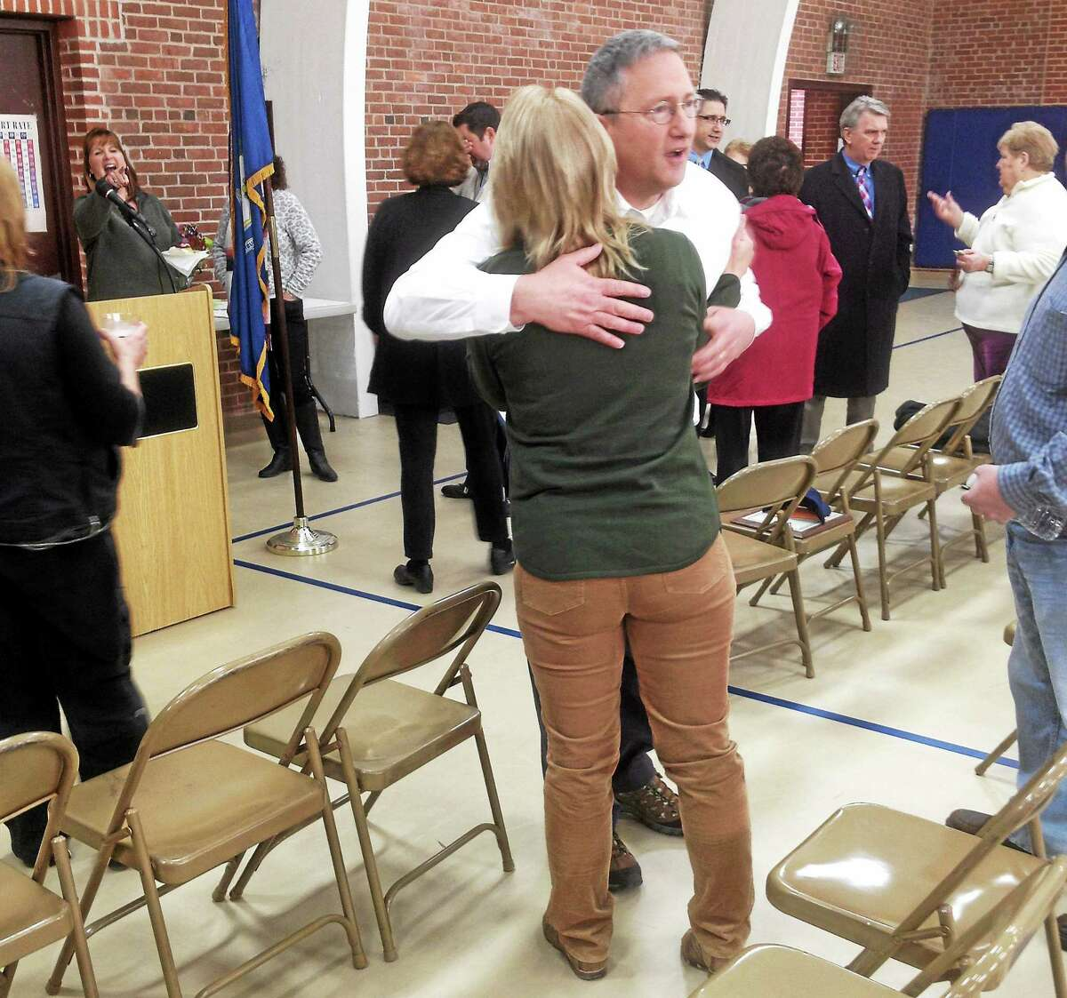 Cromwell Town Manager Jonathan B. Sistare, center, shares a moment with Director of Finance Marianne Sylvester and Director of Public Work Louis Spina during a farewell reception in Sistare's honor Friday. The municipality's first town manager, Sistare is returning to his native New Hampshire.