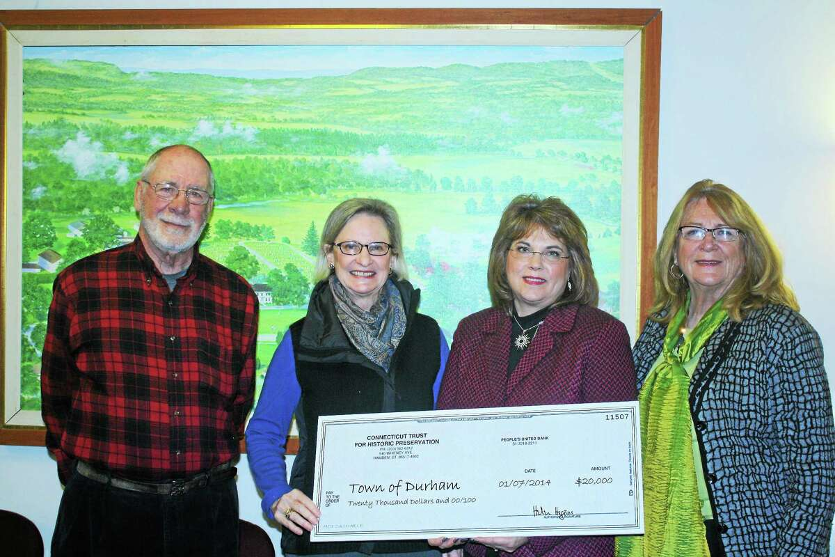Durham First Selectwoman Laura Francis (center) accepts a $20,000 grant from The Connecticut Trust for Historic Preservation. The grant will be used for pre-construction planning to incorporate two historic houses located in the Durham Historic District on Main Street into the town's plans for a public safety complex.