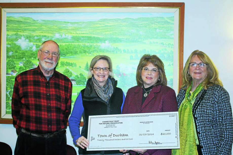 Durham First Selectwoman Laura Francis (center) accepts a $20,000 grant from The Connecticut Trust for Historic Preservation. The grant will be used for pre-construction planning to incorporate two historic houses located in the Durham Historic District on Main Street into the town's plans for a public safety complex. Photo: Submitted Photo.