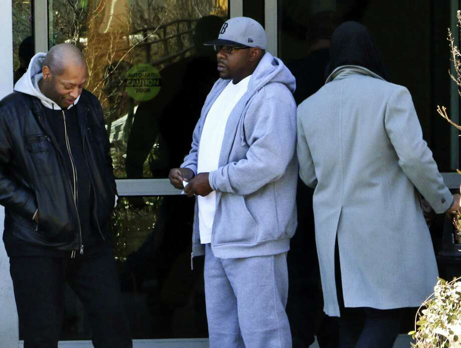 In this image made from video, entertainer Bobby Brown, center, stands outside of Emory Hospital in Atlanta where his daughter Bobbi Kristina Brown is being treated, Thursday, Feb. 5, 2015. Photo: AP Photo/Ron Harris  / AP