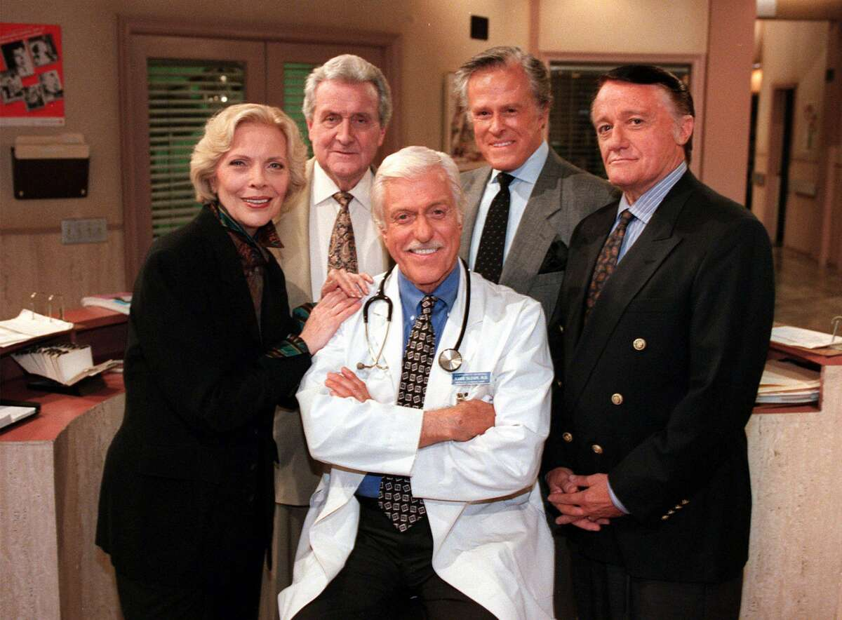 """FILE - In this Oct. 16, 1997 file photo, Dick Van Dyke, center, poses with his guest stars, from left, Barbara Bain, Patrick Macnee, Robert Culp and Robert Vaughn, on """"Diagnosis Murder"""" during a break on the set of the CBS series in the Van Nuys section of Los Angeles. Macnee, star of the 1960s TV series ìThe Avengers,î has died at age 93. His son Rupert said in a statement that Macnee, died Thursday, June 25, 2015, at his home in Rancho Mirage. (AP Photo/Reed Saxon, File)"""