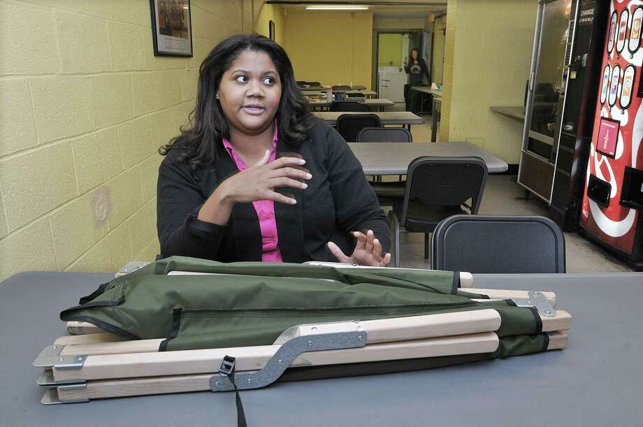 Mackenzie Tyson, Program Manager at the Eddy Shelter of Middlesex County on the grounds of Connecticut Valley Hospital in Middletown is photographed in the shelter's cafeteria Tuesday afternoon. Tyson said during the winter month's, the facility increases from the typical 30 beds to 40 and are often forced to set up cots in the cafeteria. Catherine Avalone - The Middletown Press Photo: Journal Register Co. / TheMiddletownPress