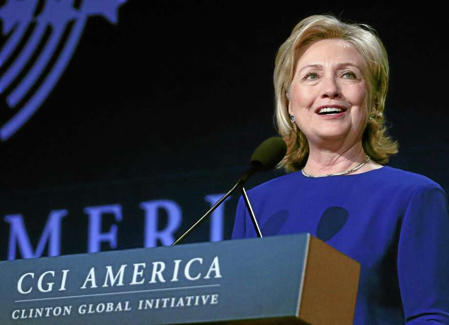 Former Secretary of State Hillary Rodham Clinton speaks to gathered participants at the annual gathering of the Clinton Global Initiative America, at the Sheraton Downtown, in Denver, Tuesday, June 24, 2014. (AP Photo/Brennan Linsley) Photo: AP / AP
